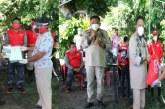 Sekprov Silangen Dampingi Gubernur Olly Bagikan 1000 Sertifikat Redis di Minahasa